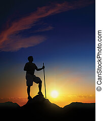 Summit at Dawn - Hiker at the summit of a mountain with the...