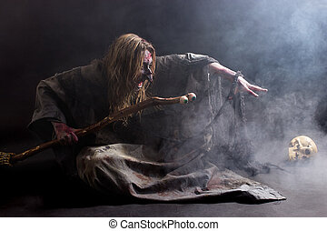 Summoning - A witch summoning in the dark with a lot of fog