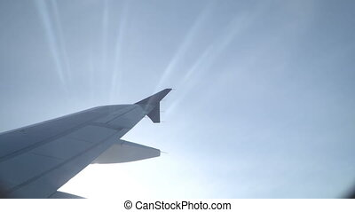 Sun and airplane wing