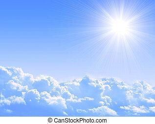 Bright sun in the blue sky