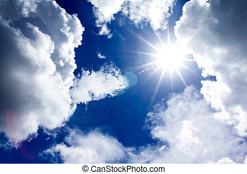 sun and  clouds in blue sky