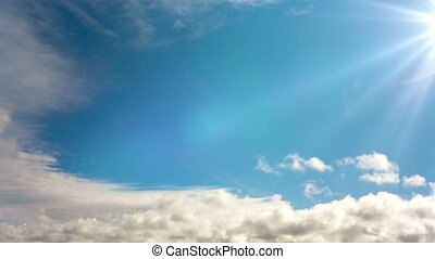 Sun and clouds in the blue sky , time lapse