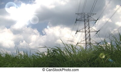 Sun and electricity - Electricity pylon with sun and green...