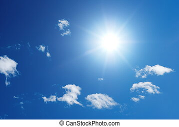 Sung in a blue sky with little white puffy clouds