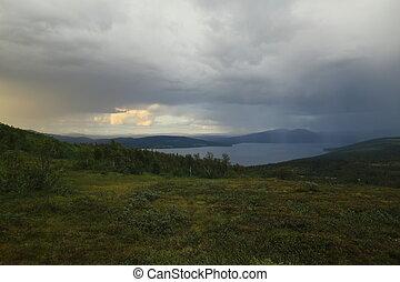 Sun and rain in Blasjofjalls nature reserve near the Wilderness Road in Sweden