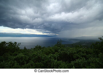 Sun and rain on lake Tornetrask, seen from mount Nuolja.