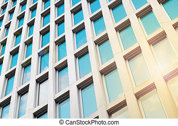 sun and sky reflection in office building facade, real estate concept -