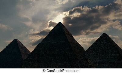 Sun comes out from behind clouds above pyramids