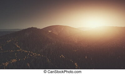 Sun beam mountainous wood peak slope aerial view - Sun Beam...