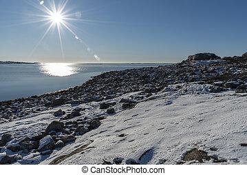 Sun beams at sea in winter