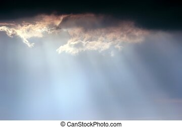 Sun beams in heaven - clouds announcing a tropical storm,...