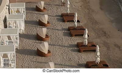 Sun beds and umbrellas on the beach. Montenegrin beaches of...