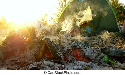 Sun bonfire camp sunset - Camping tent and bonfire by...