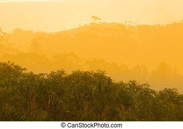 Sun breaking through clouds in rainstorm