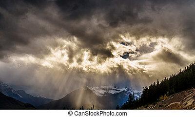 Sun breaking through Dark clouds