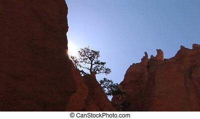 Sun breaks over rock, time lapse