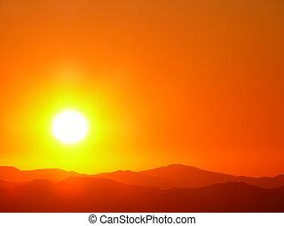 Sun Burst - Orange sun burst glows brightly in the western...