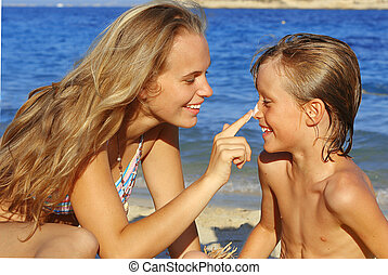sun care, mother putting suncream on child