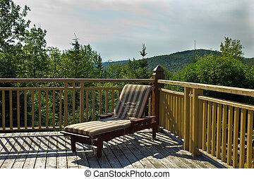 Sun chair on a wooden deck