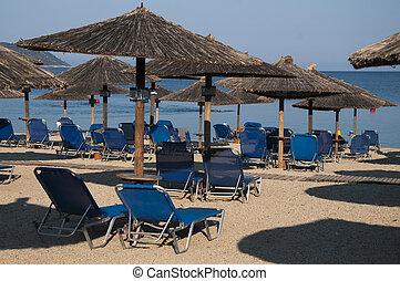 Sun chairs and umbrella on beach