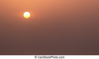 Sun close-up at sunset timelapse. Aerial view from Jumeirah...