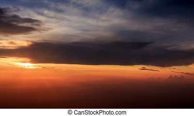 Sun Disk on Skyline above Clouds out of Airliner at Sunset