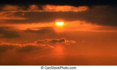 Sun disk through sky clouds