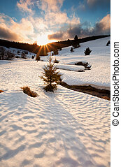 sun down over mountain river in winter, Germany