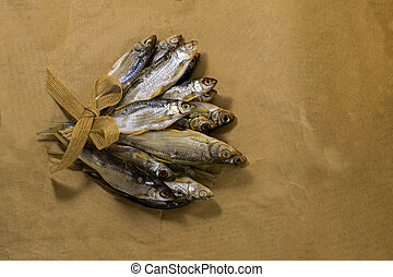 Sun dried fish. Fish on the brown paper.