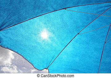 Sun Filtering Through Blue Sun Umbrella
