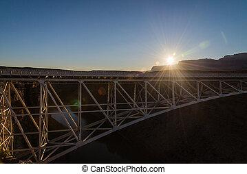 Sun flare brust on the Navajo bridge in Sunset view