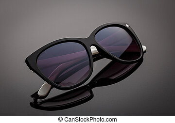 Sun glasses on gray background