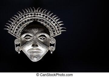 Sun God Mask - Sun God mask isolated against a black...