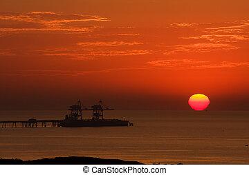 Sun goes down on Mediterranean sea.