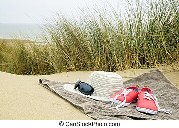 hat, shoes and sun glasses on beach towel - sun hat, shoes ...