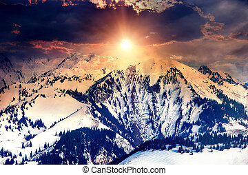 Sun in mountains on cloud sky background.