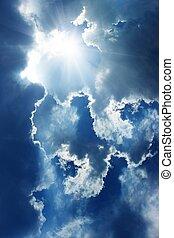Sun in sky - Bright sun in blue sky with clouds