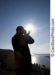 sun in the hands of men