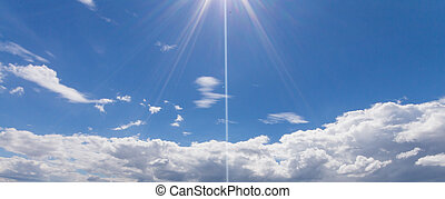 Sun light and beam on the blue sky in cloudy days