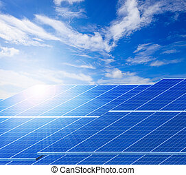 sun light and solar cell panels against beautiful clear blue sk