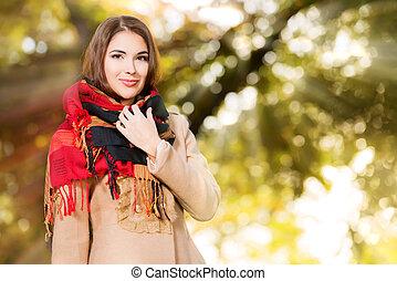 sun light - Beautiful young woman at the autumn park.