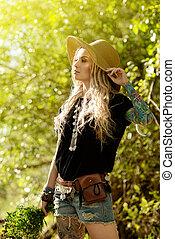 sun light - Boho style fashion. Beautiful young woman...