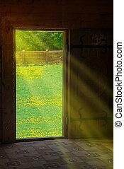 Sun light shining through wooden door