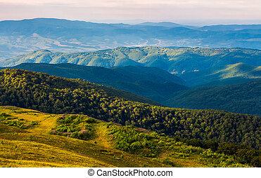sun lit valley in afternoon. beautiful mountainous landscape...