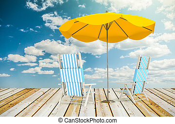 Sun loungers and umbrella