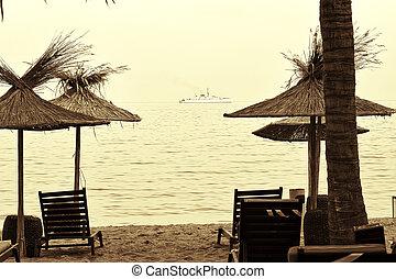 Sun loungers on the beach, black sea