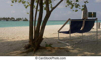 Sun loungers on the beautiful tropical beach. Maldives. 4k