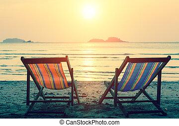Sun loungers on the sea beach.