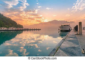 Sun Moon Lake reflection water lake with tour jetty during sunrise