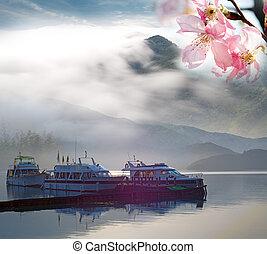 Sun moon lake with sakura
